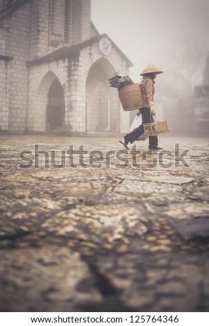 Vietnamese woman walking on the street