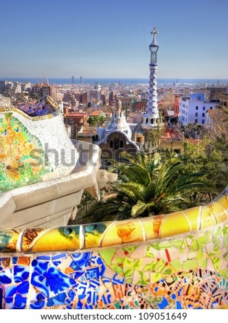 Vieuw over the city of Barcelona from the Park Guell with his famous colorful mosaic seats