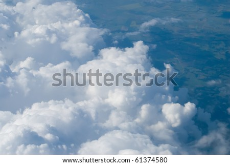 View above the earth at the clouds below - stock photo