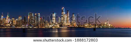 View across Hudson River of skyscrapers of New York City. Manhattan skyline at sunset from Midtown West to Lower Manhattan (Hudson Yards and World Trade Center). NY, USA Stock photo ©