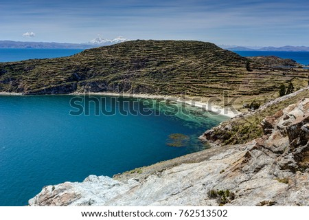View across La isla del Sol with blue Sky water and trees Lake T #762513502