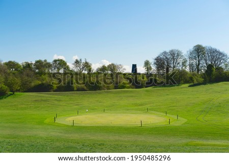 View across public parkland,  golf course, and disused mill on horizon on bright morning in spring Beverley, Yorkshire, UK. Stock photo ©