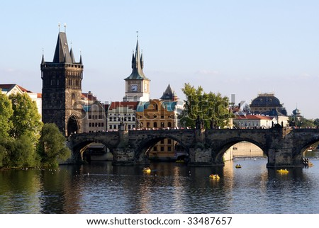 View across the river Vltava (Moldau) to Charles Bridge and old town of Czech capital Prague