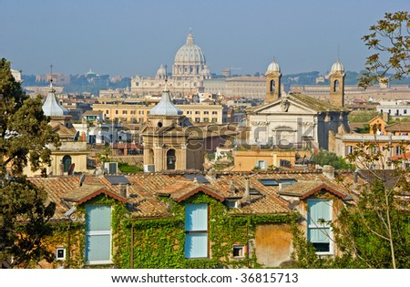 View across the rooftops of Rome and the  cupola of St. Peter's in the  Vatican City.