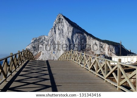 View across wooden footbridge towards the Rock of Gibraltar, La Linea de la Concepcion, Costa del Sol, Cadiz Province, Andalucia, Spain, Western Europe.