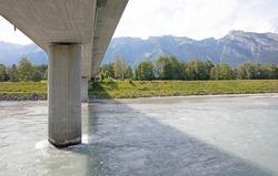 View along a concrete bridge across the River Rhine