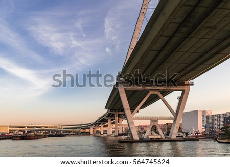 View along a steel bridge across the River with boat in sunset time #564745624