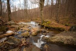View along the Dark Hollow Falls trail at Shenandoah, Virginia, USA in winter
