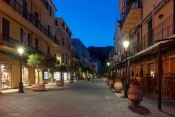 View along typical Italian narrow street in Alassio old town, Liguria region