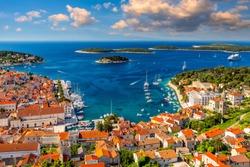 View at amazing archipelago in front of town Hvar, Croatia. Harbor of old Adriatic island town Hvar. Popular touristic destination of Croatia. Amazing Hvar city on Hvar island, Croatia.