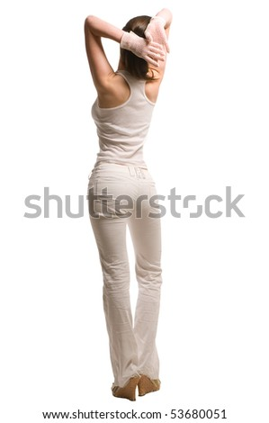 View at beautiful model woman from back view dressed in white pants and undershirt