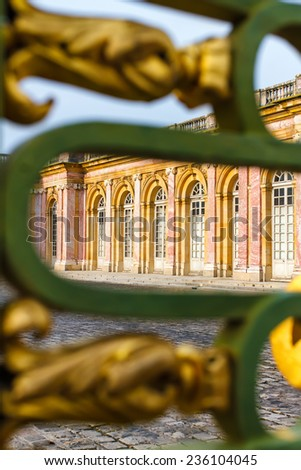 View at Grand Trianon Versailles through the fence. Focus on the palace