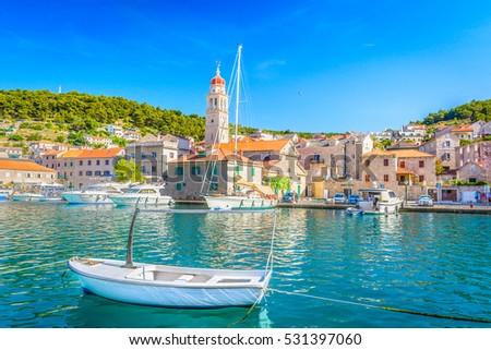 View at mediterranean summertime scenery in Croatia, Pucisca town, Island Brac. / Adriatic coast town Pucisca. / Selective focus.