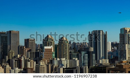 View at modern courtyard. Facade of modern building. Sao Paulo city, Brazil. South America. Flying helicopter #1196907238