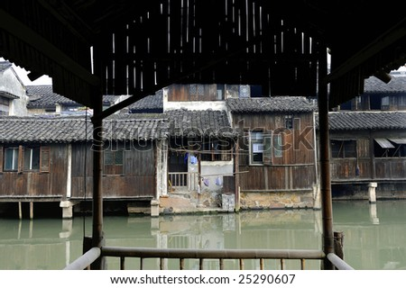 View at some old wooden houses in the water village of Wuzhen, near Shanghai in China.The roofs are typical for this village.