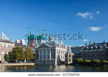 View at the Dutch parliament buildings in The Hague, The Netherlands with a blue sky in the background