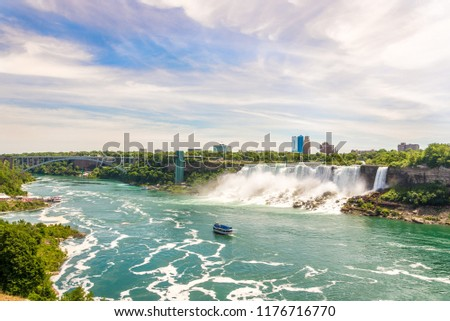 View at the Rainbow International bridge over Niagara river with American falls and Bridal Veil falls at USA territory from Niagara falls in Canada