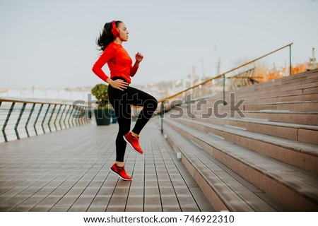 View at young woman exercising outside #746922310