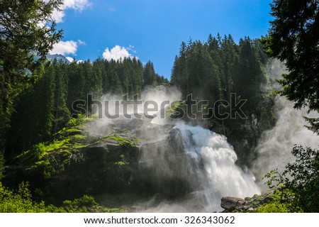 View beauty Alpine inspiring Krimml waterfall in mountains, clear blue sky, deep rich green forest, spruce, trees. summer day. trekking in National park Hohe Tauern, Austria, Europe. Poster Image #326343062