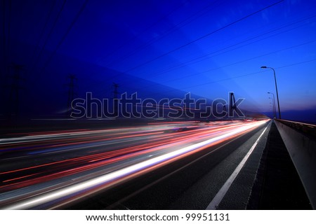 View City-highway vehicles in the evening rainbow light trails