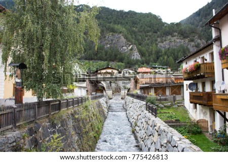View cityscape and landscape of classic building and small waterway Pfunds village in Tyrol, Austria