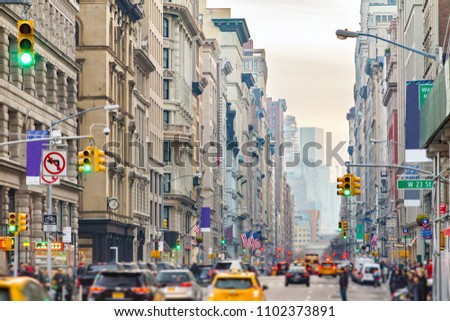 View down Broadway in New York City with people and cars lining the street through Midtown Manhattan #1102373891