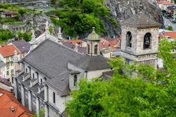 View down over the roof and steeple of the Collegiate Church of Saints Peter and Stephen in Bellinzona, canton of Ticino, Switzerland.