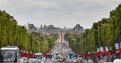 View down the Champs Elysees towards the Grand palace with traffic and heat haze