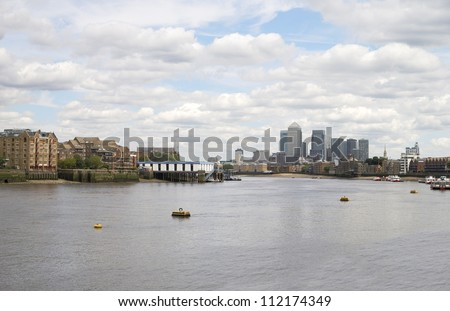 View down the River Thames towards Canary Wharf from Saint Saviours Dock in Southwark. Near Tower Bridge. London. England