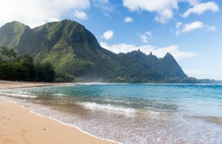 View down the sand at Tunnels Beach in winter on Hawaiian island of Kauai on North Shore