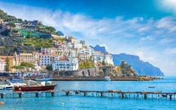 View for sea to beautiful Amalfi on hills leading down to coast, Campania, Italy. Amalfi coast is most popular travel and holyday destination in Europe.
