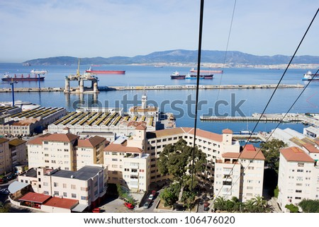 View from a cable car on an urban scenery of Gibraltar town and bay.