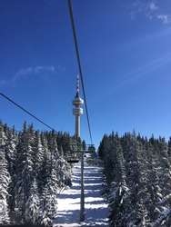 View from a chairlift going up to a ski slope in the Pamporovo ski resort in Bulgaria.
