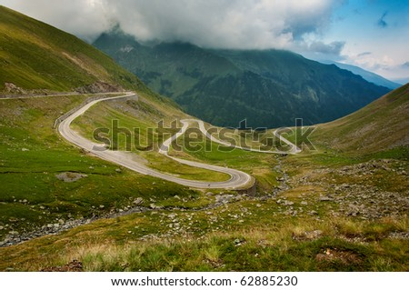 View from a halting place in Fagaras mountains of a curvy highway