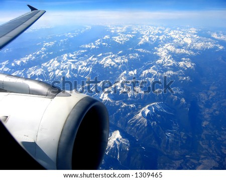 View from a jet plane over the Rocky Mountains - stock photo