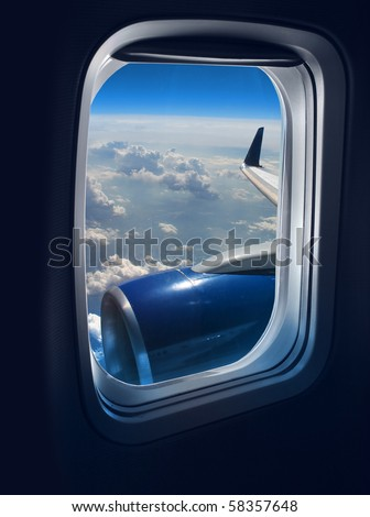 View from a jet plane window high on the blue skies