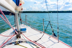 view from a main deck of sailboat on a lake. Summer recreational pursuit