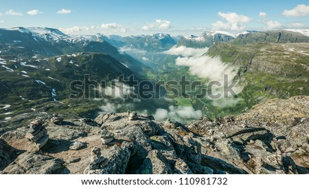 View from a mountain top on Geiranger and Geirangerfjord, Norway. Mount Dalsnibba.