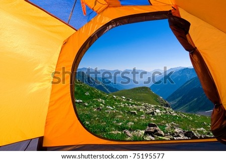 view from a touristic tent to a blue misty mountains #75195577