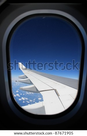 view from a window outside an airplane - stock photo