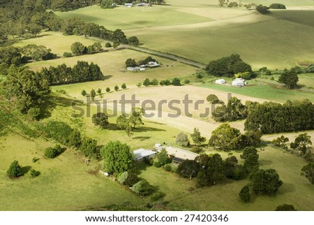 View from above of a patchwork of fields and small farmsteads, Victoria, Australia
