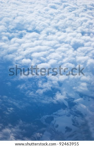 View from above of earth through clouds