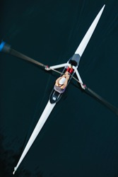 View from above of single scull crew racer, Lake Union, Seattle, Washington, USA.