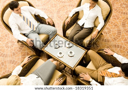View from above of sitting business partners during negotiations in office