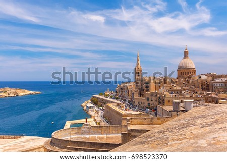 View from above of the golden domes of churches and roofs with church of Our Lady of Mount Carmel and St. Paul's Anglican Pro-Cathedral, Valletta, Capital city of Malta Stock fotó ©