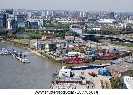 View from above of the River Thames and River Lea and the island with Trinity Buoy Wharf in Newham, East London. East India Dock basin behind View from public transport.