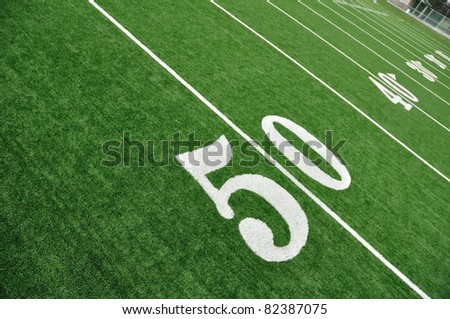 View From Above of 50 Yard Line on American Football Field With Artificial Turf