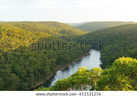 View from above on Royal National Park forest and Hacking river from Bungoona Lookout #611521256