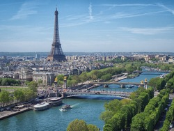 View from above on the Seine river (Paris) with the Eiffel tower on the horizon