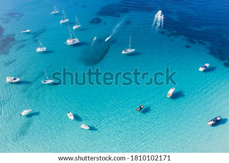 View from above, stunning aerial view of a bay with boats and luxury yachts sailing on a turquoise, clear water. Grande Pevero, Emerald Coast (Costa Smeralda) Sardinia, Italy.